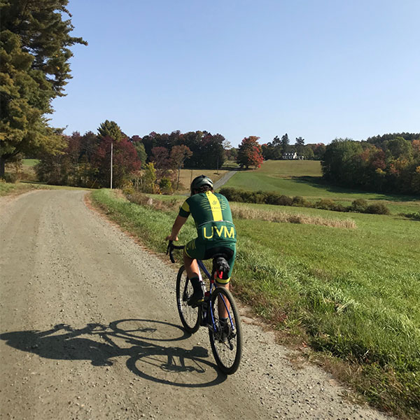 Man biking on gravel road