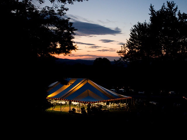 Tent on lawn at dusk